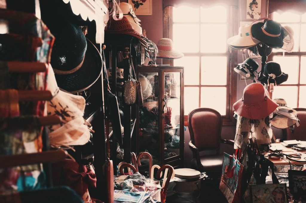 Vintage shop filled with hats and handbags