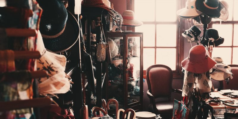 Vintage shop with vintage clothes, hats and handbags