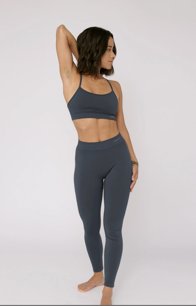 Girl wearing grey set of organic yoga clothes
