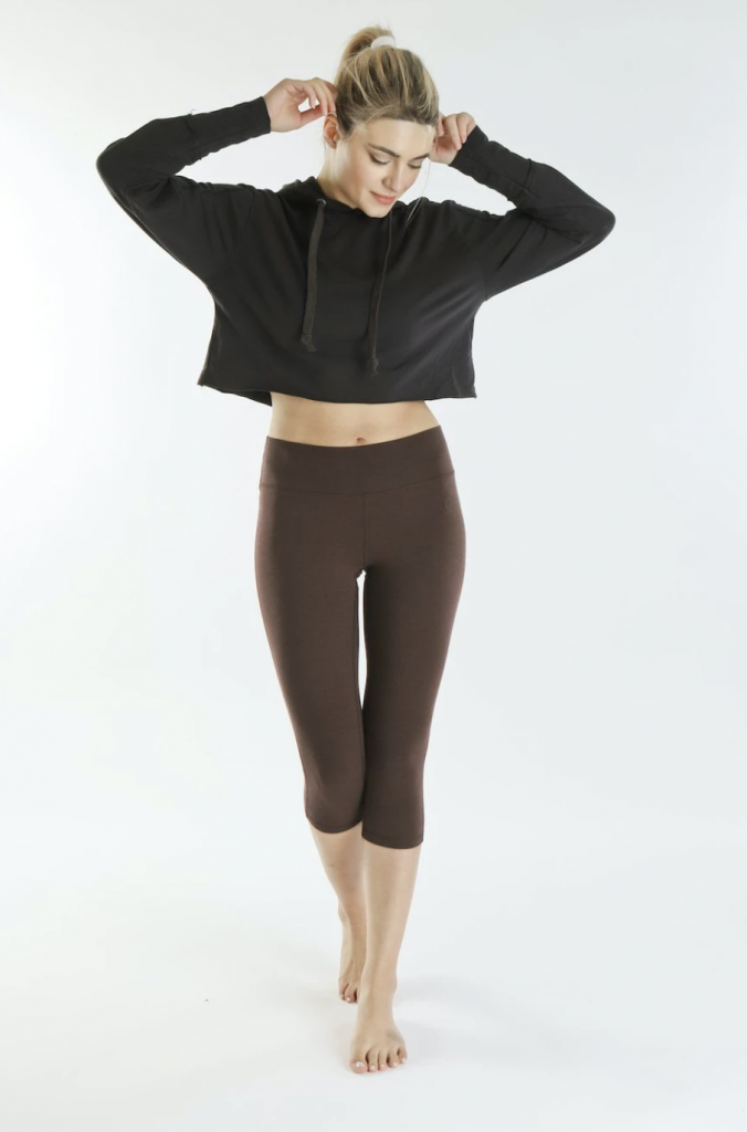 girl in organic black hoodie and brown ethical yoga pants