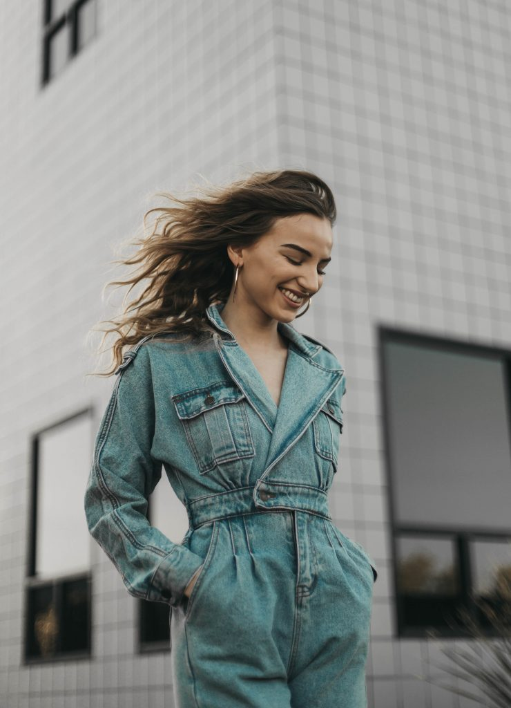 girl with brown hair in denim jumpsuit