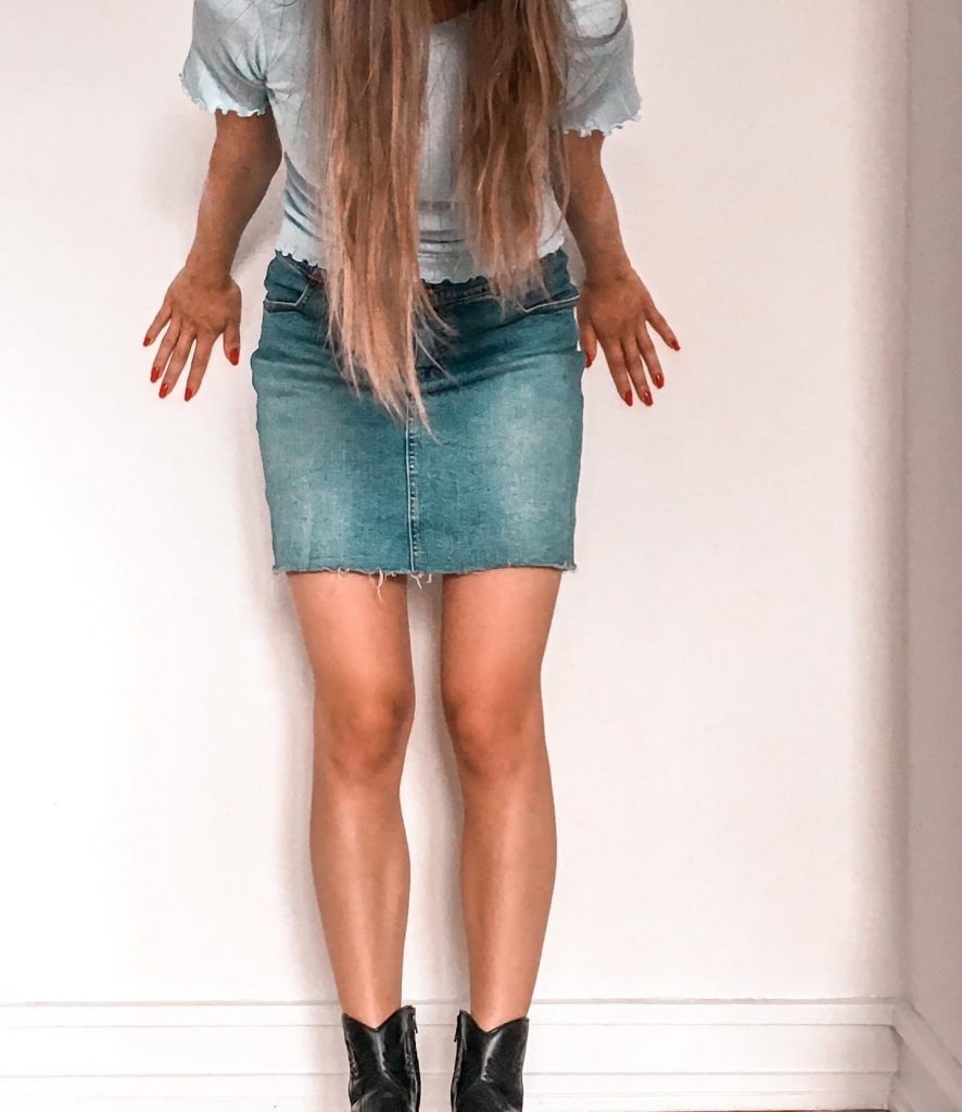 Girl wearing recycled skirt and upcycled shirt