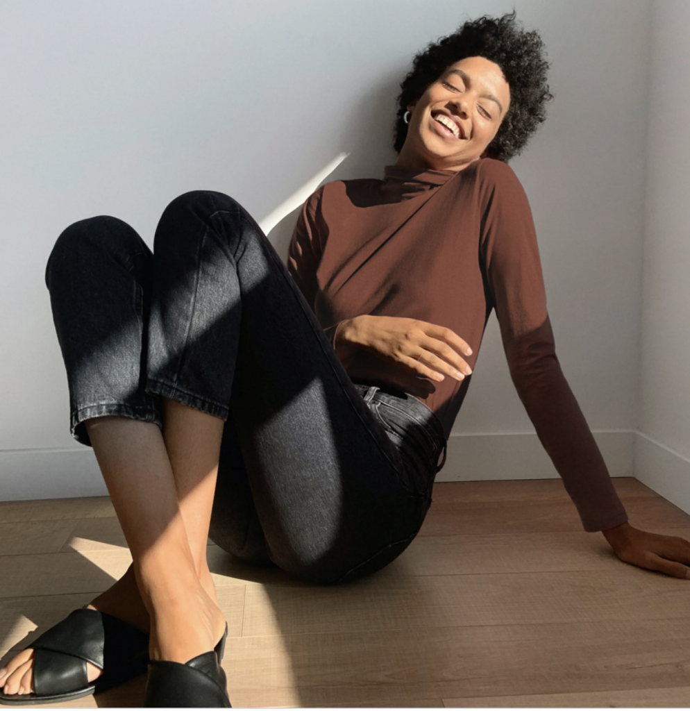 Woman laughing while sitting on the floor