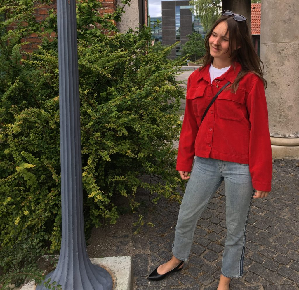 red second-hand jacket and vintage jeans