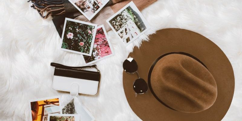 Brown sustainable hat and polaroid pictures