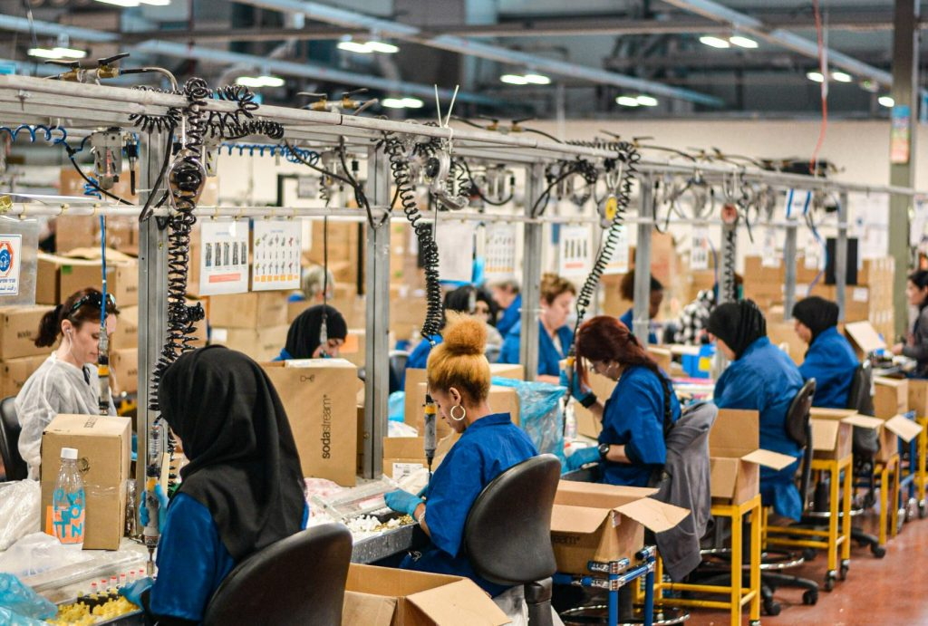 women working in a clothing supply chain factory
