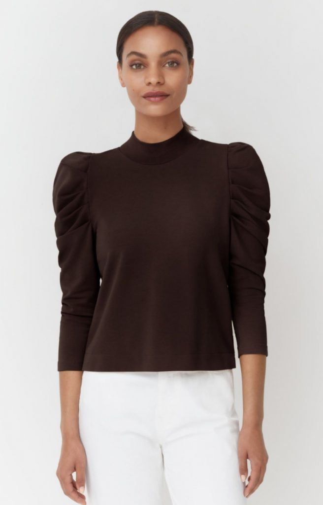 brown ethical turtleneck